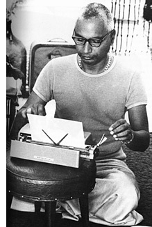 Swami Venkatesananda at his typewriter